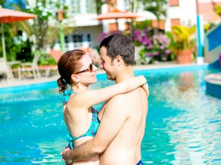 Honeymoon Couple near a blue swimming pool